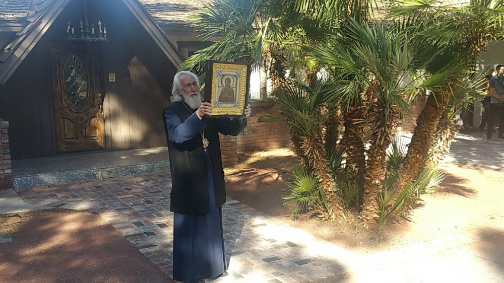 "Vladyka Nikolai blessing with the icon of the Theotokos ""Softener of Evil Hearts"" in Las Vegas"